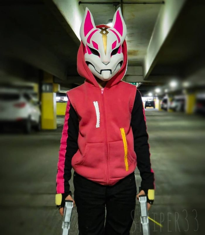 kids in a parking with fortnite pink kitsune mask