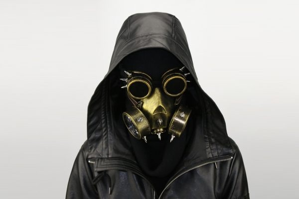 men with a gold purge gas mask